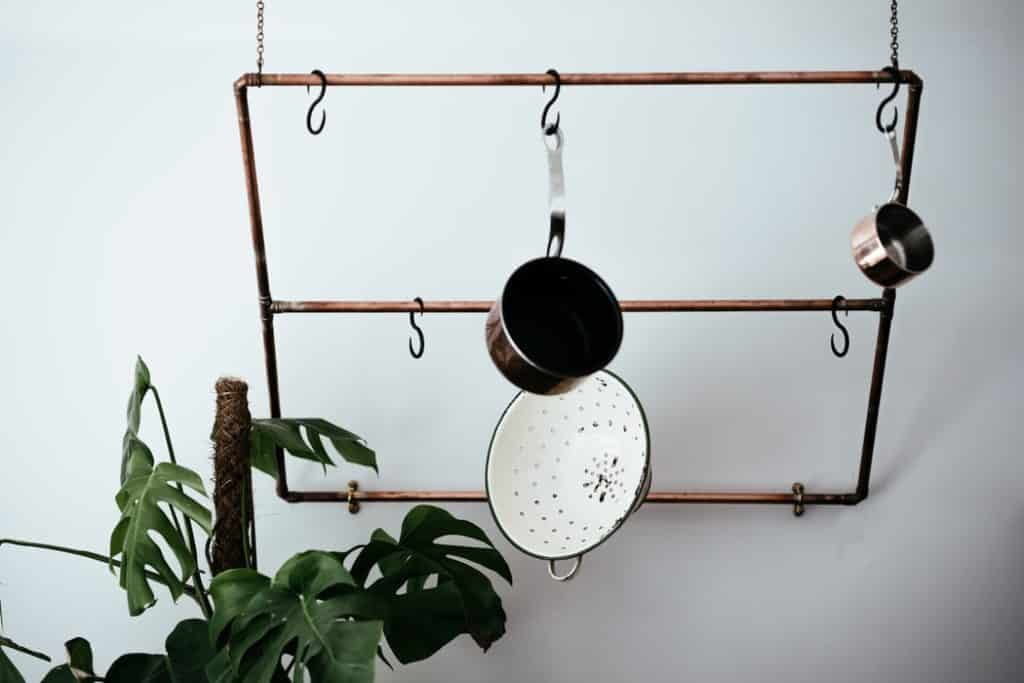 pot rack with hanging pots and pans